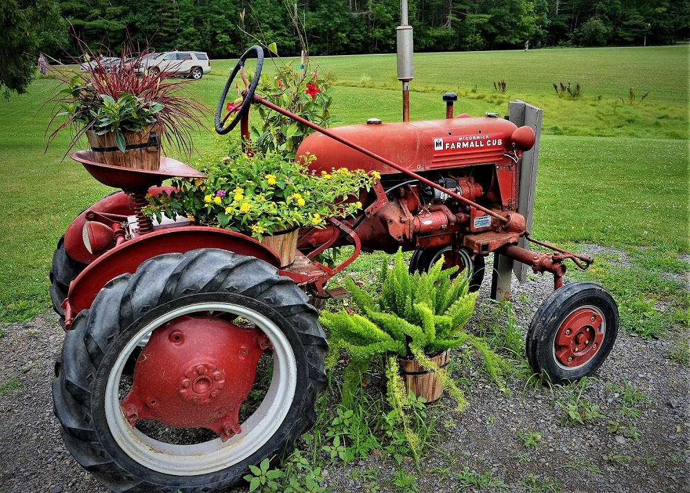 Tractor at Glimmerglass aaduna spring summer cover art William E Berry, Jr. photographer